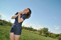 Woman enjoying life outdoors Stock Photos