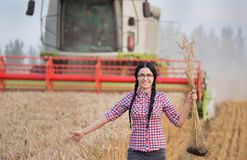 Woman enjoying life in wheat field royalty free stock image