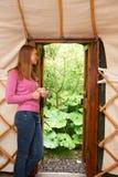 Woman Enjoying Luxury Camping Holiday In Yurt Royalty Free Stock Photo
