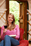 Woman Enjoying Luxury Camping Holiday In Yurt Royalty Free Stock Photo