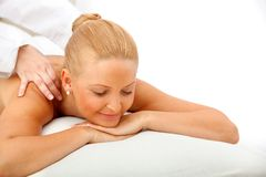 Woman enjoying a massage Royalty Free Stock Photos
