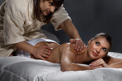 Woman enjoying a massage. Beautiful women enjoying a massage on bed Stock Photos