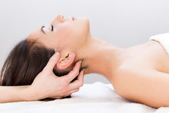 Woman enjoying massage at beauty spa Stock Photography