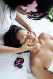 Woman enjoying a massage day at the spa Stock Images