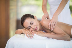 Woman enjoying massage from female masseur Stock Photography