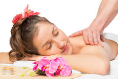 Woman enjoying a massage and spa Stock Photography