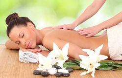 Woman enjoying a massage therapy Stock Photo