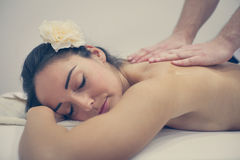 Woman enjoying a massage treatment. Woman during a massage treatment Royalty Free Stock Image