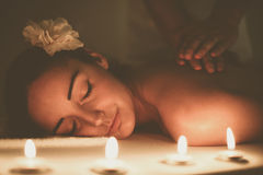 Woman enjoying a massage treatment. Woman during a massage treatment in spa Stock Photo