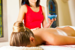 Woman enjoying massage in wellness spa Royalty Free Stock Photos