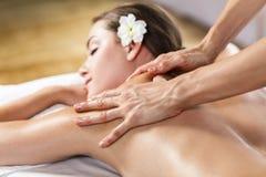 Woman enjoying massage. Stock Photography