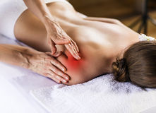 Woman enjoying massage. Stock Photo