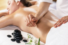 Woman enjoying massage. Royalty Free Stock Photography