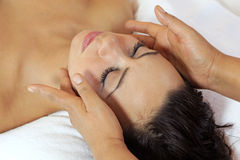 Woman enjoying massage Stock Images