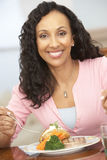 Woman Enjoying A Meal At Home Stock Images
