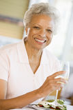 Woman Enjoying meal,mealtime With A Glass Of Wine Stock Image