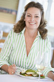 Woman Enjoying meal,mealtime With A Glass Of Wine Royalty Free Stock Images
