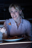 Woman Enjoying Meal Whilst Watching TV Royalty Free Stock Photography