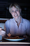 Woman Enjoying Meal Whilst Watching TV Stock Images