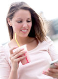 Woman enjoying a milkshake Royalty Free Stock Photo
