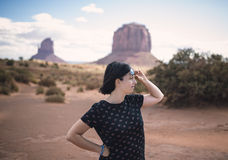 Woman enjoying in Monument Valley with sunglasses. Stock Photos