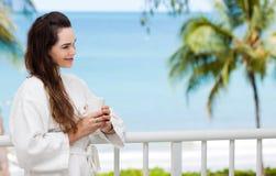 Woman enjoying morning drink Stock Images