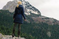 Woman enjoying mountain lake view. Freedom, travel concept. Royalty Free Stock Images