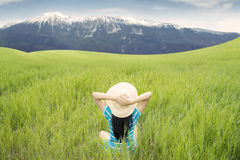 Woman enjoying mountain view on meadow Stock Photography