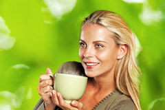 Woman enjoying a mug of tea Royalty Free Stock Photos