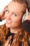 Woman enjoying music Stock Image