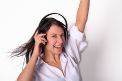Woman enjoying music Stock Images