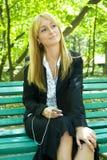 Woman enjoying music. A young businesswoman enjoying music in her break Royalty Free Stock Photo