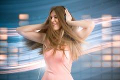 Woman enjoying in music Royalty Free Stock Image