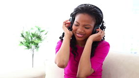 Woman enjoying music with headset Stock Photos