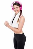Woman enjoying music while jogging Stock Image