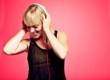 Woman Enjoying the Music from MP3 Player Stock Photo
