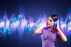 Woman enjoying in music. Over design background Stock Photography