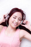 Woman enjoying the music Royalty Free Stock Images
