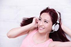 Woman enjoying the music Stock Image