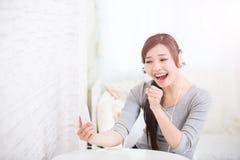 Woman enjoying the music royalty free stock photography