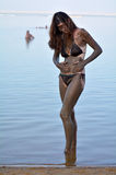 Woman enjoying the natural mineral mud sourced from the Dead Sea Royalty Free Stock Photo