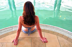 Woman enjoying natural mineral salty water in the Dead Sea, Isra. Young woman enjoying natural mineral salty water in indoor pool in a resort in the Dead Sea Stock Photography