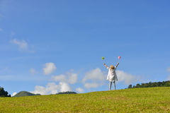 Woman enjoying the nature. On blue sky background Royalty Free Stock Photos