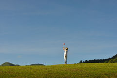 Woman enjoying the nature. On blue sky background Royalty Free Stock Photography
