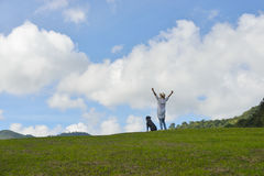 Woman enjoying the nature on blue sky background Stock Image