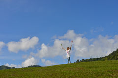 Woman enjoying the nature. On blue sky background outdoors Stock Photography