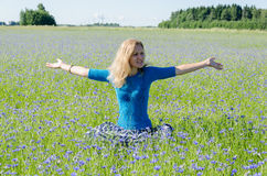 Woman enjoying nature in harmony cornflower meadow Royalty Free Stock Photos