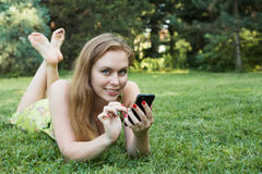 Woman enjoying nature smartphone Stock Photos