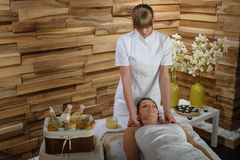 Woman enjoying neck massage at luxury spa Royalty Free Stock Photo