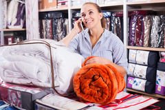 Woman enjoying new blanket and coverlet Royalty Free Stock Image